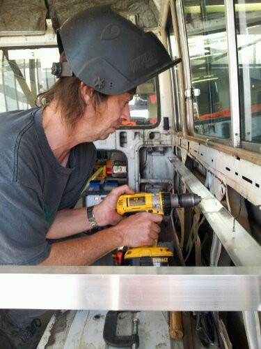 rob drilling a hole for the rivets