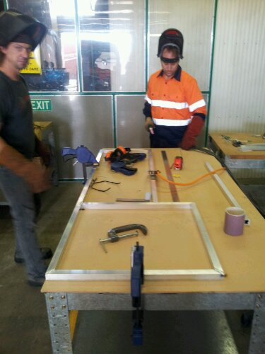 kitchen bench frame coming together (with rob trying to sneak out of shot!)